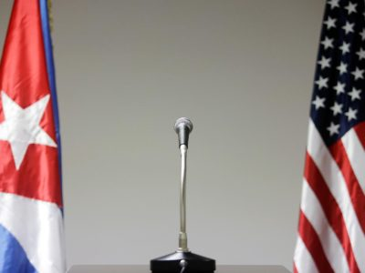 HAVANA, CUBA - JANUARY 22: A microphone is placed between the flags of the US and Cuba in the press briefing room during the first round of talks with the US government to discuss diplomatic recognition, at the Palacio de las Convenciones, on January 22, 2015 in Havana, Cuba.  Roberta Jacobson, U.S. Assistant Secretary of State for Western Hemisphere Affairs, is the highest ranking government official to visit Cuba since the Jimmy Carter era. Talks between the US and Cuba take place only weeks after President Obama and Cubas President Raul Castro announced they would re-establish diplomatic relations, on December 17, 2014. Cubas revolution leader Fidel Castro, who has not been seen in public since January 8, 2013, has not published
